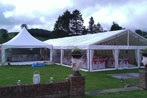 6x6m  with a Pro Panoramic window wall attached to other marquee